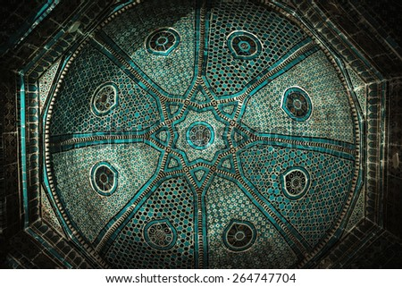 SAMARQUAND, UZBEKISTAN - MARCH 14, 2015: Registan square. Fragment of an ancient dome. The ancient city is part of UNESCO World Heritage. - stock photo