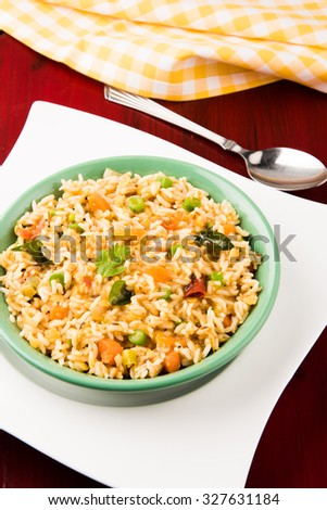 sambar rice / rice sambar / sambar mixed with rice, tasty south indian dish served in a terracotta bowl, isolated and top angle over white background
