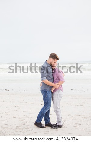 Same sex gay male couple on the beach in Cape Town South Africa, being very in love and happy