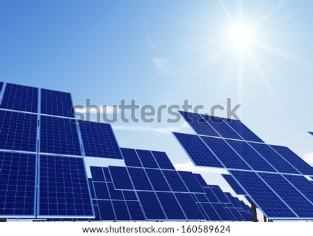 same solar panel towers with sun
