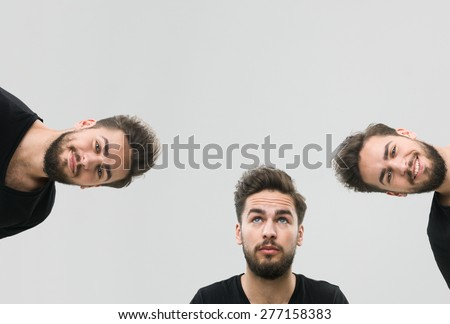 same young man captured with different facial expressions, against grey background. copy space available