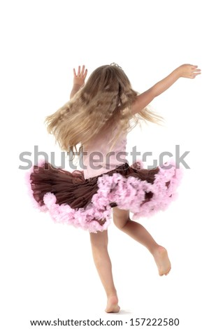 Samll dancing girl in studio - stock photo