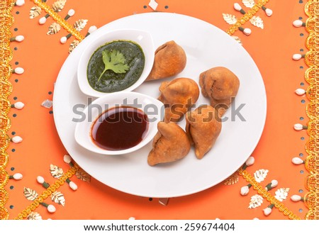 Samosa Indian traditional fast food snack dish isolated on decorative background in festival time - stock photo