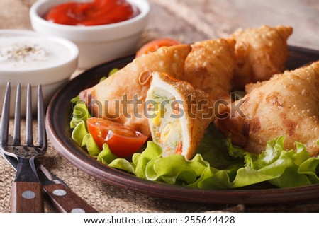 samosa stuffed with vegetables on a plate close-up. horizontal