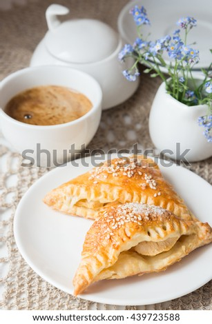 Samosa with apples and cup of coffee - stock photo