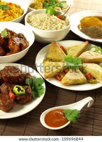 Samosas, rice, bhajis, pakoras and additions - stock photo