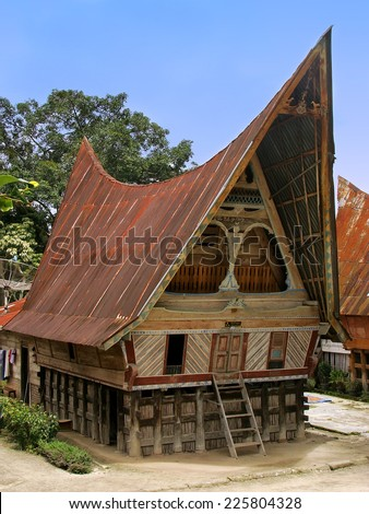 SAMOSIR, INDONESIA - MARCH 6: Traditional Batak house on March 6, 2012 on Samosir island, Indonesia. Samosir is the largest island within an island and the fifth largest lake island in the world. - stock photo