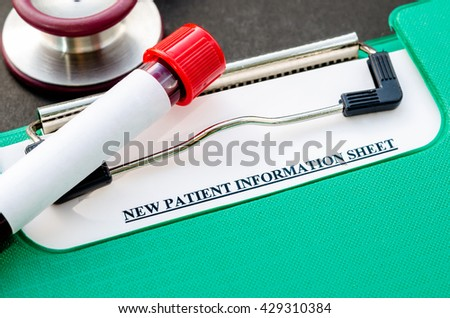 Sample blood in tube for test and New patient information sheet in file with stethoscope on black background. - stock photo