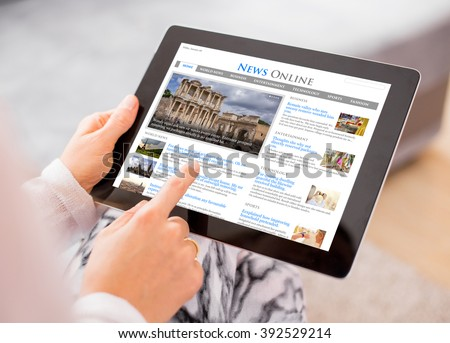 Sample news website on digital tablet. Contents are all made up. - stock photo
