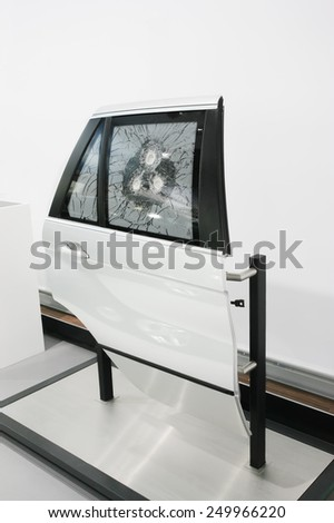Sample of bullet resistant glass is shot - stock photo