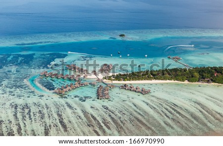 Sample of how maldives bungalow and water villa resort look like - stock photo