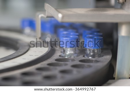 Sample vials in line waiting for analysis inside injection port