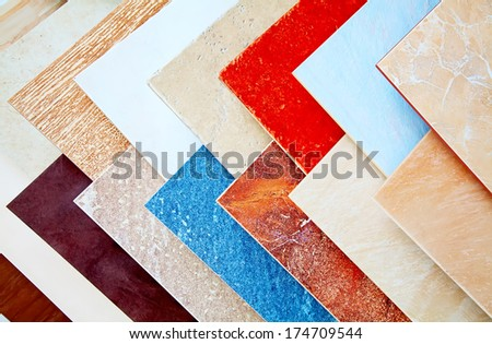 Samples of ceramic tiles in a shop. - stock photo