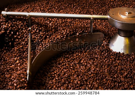 sampling of coffee beans during roasting process - stock photo