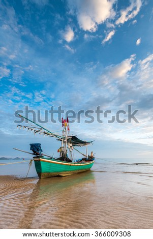 Samroiyod Beach,Thailand ,fishing boats parked on the beach, background is small island and morning light