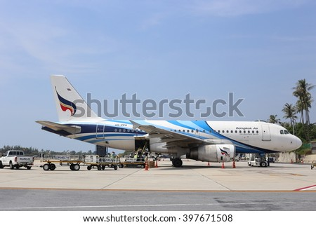 Samui,Suratthani/ Thailand - March 24, 2016 : Bangkok Airways's Airbus A319 is loading cargo at the apron of Samui International Airport.  - stock photo