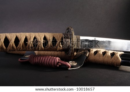 Samurai sword detail on black - stock photo