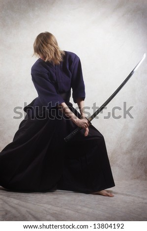 samurai with blade - stock photo