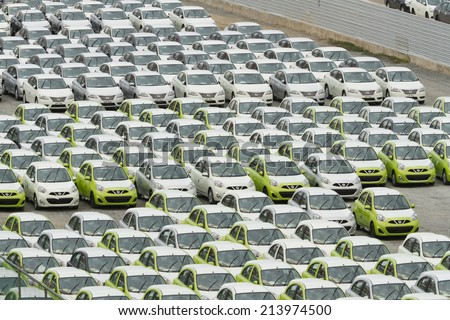 Samut Prakan,Thailand -24 August,2014:Row of new vehicles parked at storage distribution plant in Samut Prakan,Thailand.