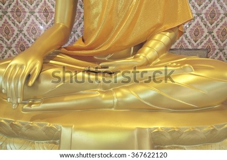 Samut Prakan- Thailand : 24 JAN 2016  Gold Buddha statues and clothed in yellow robe at Wat Bang Phli Yai Nai.