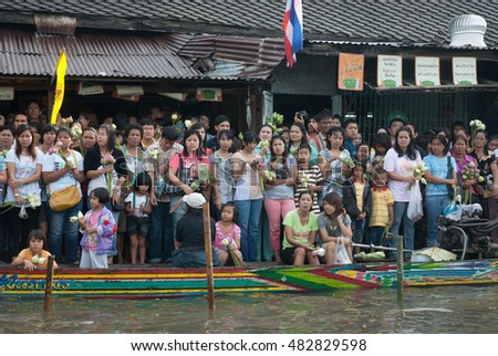 SAMUT PRAKAN,THAILAND â?? OCTOBER 3,2009 : people enjoy the Lotus throwing procession by the river ceremony on End of Buddhist Lent Day in Rub Bua Festival ,Samut Prakan Province, Middle of Thailand.