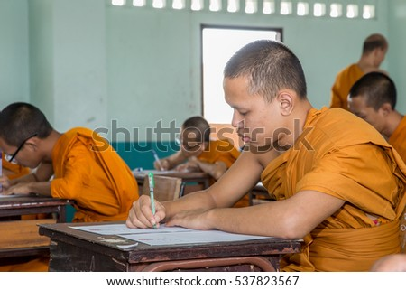 Samut Prakan, Thailand, October 13: unidentified monk Thailand to learn about Buddhism classes: front view of the college are in the top row of seats in the October 13, 2016 in Samut Prakan, Thailand.