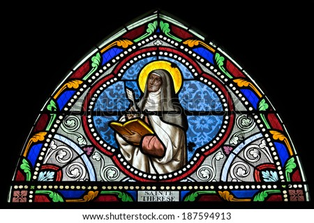 SAMUT SAKHON, THAILAND - APRIL 12: Stained glass window depicting saint in Christ Church on April, 12, 2014.