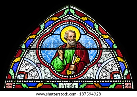 SAMUT SAKHON, THAILAND - APRIL 12: Stained glass window depicting saint in Christ Church on April, 12, 2014. - stock photo