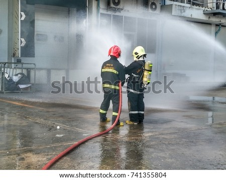 Samut Sakhon,Thailand October 21, 2017: Unidentified fireman fighting the fire in Thailand