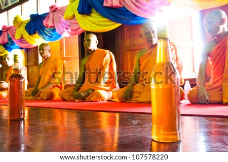 SAMUT SAKHON,THAILAND-SEPT 23 : Buddhist monks together to pray  in the tradition of giving alms Buddhist monks with honey on September 23,2010 in Samut Sakhon,Thailand.