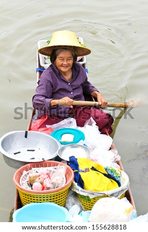 SAMUT SONGKHRAM, THAILAND - SEP 21:Local merchant sell food ,fruits and product at Thaka floating market,on September 21,2013 in Samutsongkhram,Thailand. Thaka is a popular tourist attraction.
