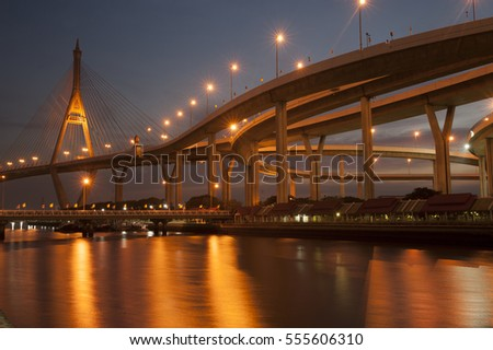 SAMUTPRAKAN ,THAILAND - DECEMBER 27,2015 : Twilight scenes of The Bhumibol Bridge,also known as the Industrial Ring Road Bridge is part of the 13 km . The bridge crosses the Chao Phraya River twice.