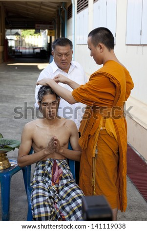 SAMUTPRAKAN THAILAND-MARCH 23:Thai monk shaving hair of a man who prepares to be new monk at wat paichayonpolsepratchaworawihan on March 23, 2013  Samutprakan Thailand