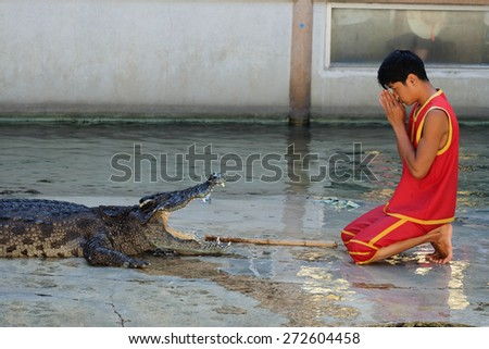 SAMUTPRAKARN,THAILAND - April 18: crocodile show at crocodile farm on April 18, 2015 in Samutprakarn,Thaila nd. This exciting show is very famous among among tourist and Thai people - stock photo