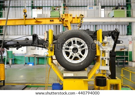 SAMUTPRAKARN, THAILAND - DEC 2015: Wheel alignment setup at cars factory, December 2015 in Thailand. - stock photo