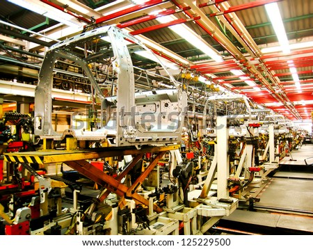 SAMUTPRAKARN, THAILAND - NOVEMBER 2 Cab of car in welding assembly line on November 2, 2012 in Samutprakarn, Thailand. Thailand have many automotive company which produce vehicle in South East Asia - stock photo