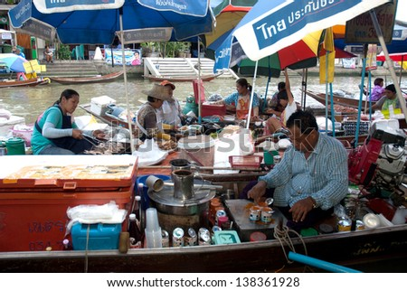 SAMUTSAKRON,THAILAND-SEPT 6 : Trader's boats in Amphawa canal, 110 km from Bangkok, most famous evening floating market and cultural tourist destination on September 6, 2012 in Samutsakron, Thailand. - stock photo