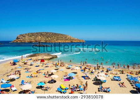SAN ANTONIO, SPAIN - JUNE 15: Sunbathers at Cala Conta beach on June 15, 2015, in San Antonio, in Ibiza Island, Spain. Ibiza is a well-known summer tourist destination in Europe - stock photo