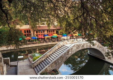 SAN ANTONIO, TEXAS, USA - SEP 27: Section of the famous Riverwalk on September 27, 2014 in San Antonio, Texas. A bustling place with many restaurants and bars. - stock photo