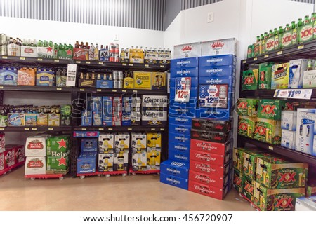 SAN ANTONIO, US - JUN 25, 2016: Various bottles of craft, microbrews, IPAs, domestic and imported beer beers from around the world on shelf display in supermarket. Alcohol background, different beers.