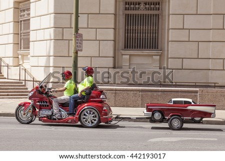 SAN ANTONIO, USA - APR 11, 2016: Couple on the Honda Goldwing trike with a trailer in the city. Texas, United States