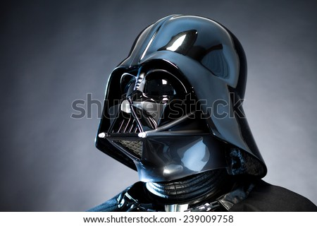 SAN BENEDETTO DEL TRONTO, ITALY. DECEMBER 5, 2014. Close up portrait of Helmet replica of the costume of Darth Vader (Dart Fener). Studio portrait with grazing blue light and black background - stock photo