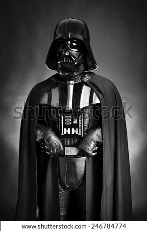 SAN BENEDETTO DEL TRONTO, ITALY. DECEMBER 5, 2014. Front portrait of a replica of the costume of Darth Vader . Darth Vader or Dart Fener is a fictional character of Star Wars saga. Black background - stock photo