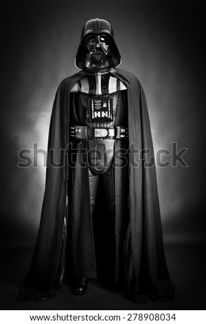 SAN BENEDETTO DEL TRONTO, ITALY. DECEMBER 5, 2014. Studio portrait of Darth Vader costume replica . Darth Vader is a fictional character of Star Wars saga. Black background. Black and white picture - stock photo