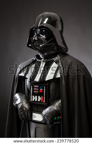 SAN BENEDETTO DEL TRONTO, ITALY. DECEMBER 5, 2014. Three quarters portrait of Dart Vader costume replica . Darth Vader or Dart Fener is a fictional character of Star Wars saga. Black background - stock photo