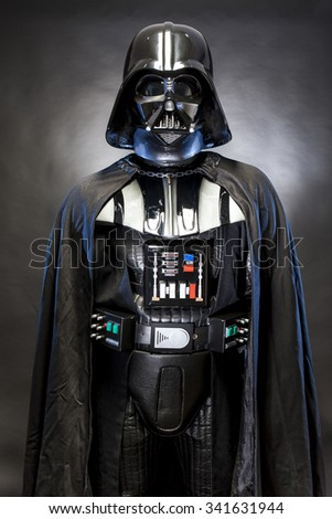 SAN BENEDETTO DEL TRONTO, ITALY. MAY 16, 2015. Half-lenght portrait of Darth Vader costume replica . Lord Fener is a fictional character of Star Wars saga.  Blue grazing light , black background - stock photo