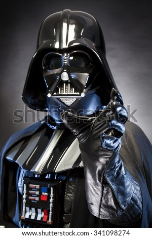 SAN BENEDETTO DEL TRONTO, ITALY. MAY 16, 2015. Portrait of Darth Vader costume replica with grab hand  . Lord Fener is a fictional character of Star Wars saga.  Blue grazing light . Black background - stock photo