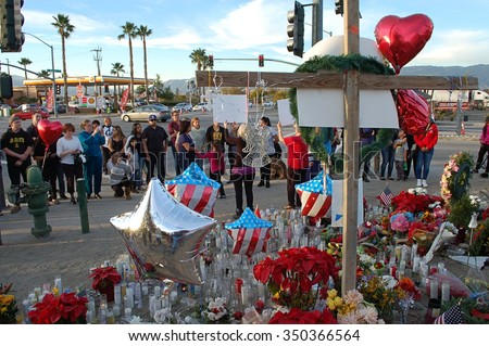 SAN BERNARDINO, CA - DECEMBER 6: People visit a makeshift memorial to IRC shooting victims on December 6, 2015 in San Bernardino, California.