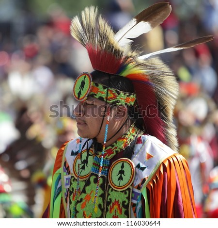 SAN BERNARDINO, CALIFORNIA - OCTOBER 13: The San Manuel Band of Indians hold their annual Pow Wow on October 13, 2012 in San Bernardino. The colorful hair roach used to be made of porcupine hair. - stock photo