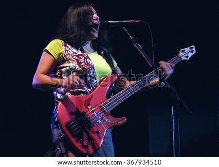 SAN BERNARDINOJULY 04:Bassist Mona Gnader performs July 4, 1999 at the Blockbuster Pavilion in San Bernardino, CA. - stock photo